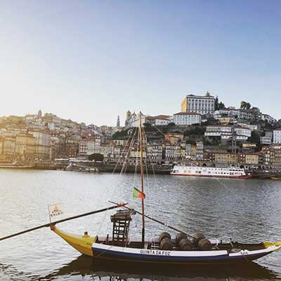 A boat sailing on the Duoro river in Porto